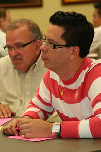 Novice Fernando Orozco listens during table discussions.  The novices are serving as tellers at the election.