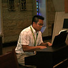 Fr Thi Pham plays the piano during Holy Hour.