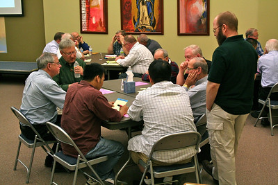 Fr. Greg Murray, moderator, listens in on one of the table discussions.