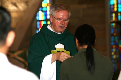Fr. Hendrik receives communion from Fr. John van den Hengel