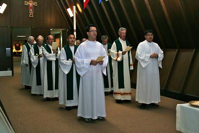 Preparing to begin the opening Mass.