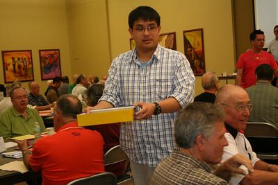 Novice Joseph Vu collects ballots