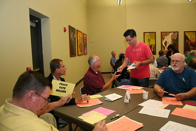 Collecting ballots.