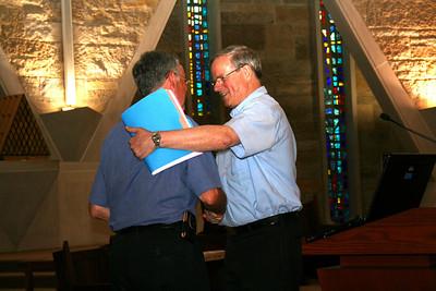 Fr. Tom received congratulations from Fr. John van den Hengel.
