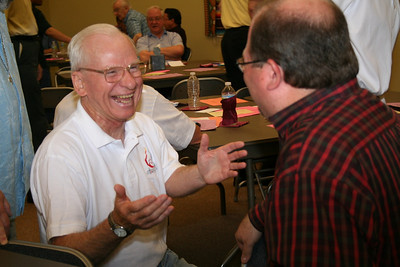 Fr. John Czyzynski congratulates Br. Duane -- his fellow formation team member -- on his election.