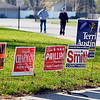 Many political signs surrounded the polling site but few poll workers were out Tuesday morning.