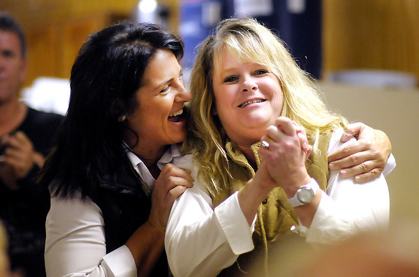 Marian Dunnichay, left, and Lisa Hobbs react to the news that Hobbs had won a seat on the County Council as election results come into Democratic Party Headquarters on Tuesday. Dunnichay won the race for County Coroner.