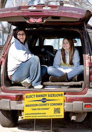 Kendra Edens and Madison Whybrew found shelter from the wind as they were working the polls at Main Street Church of God Tuesday afternoon.