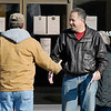 Republican candidate for County Council at large Mike Gaskill greets voters outside of Bethany Christian Church Tuesday morning.