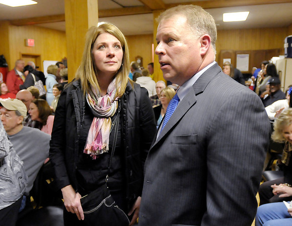 Candidate for State Representative District 35 Melanie Wright and candidate for U.S. Representative District 5 Scott Reske wait for results to come into Democratic Party Headquarters on Tuesday.