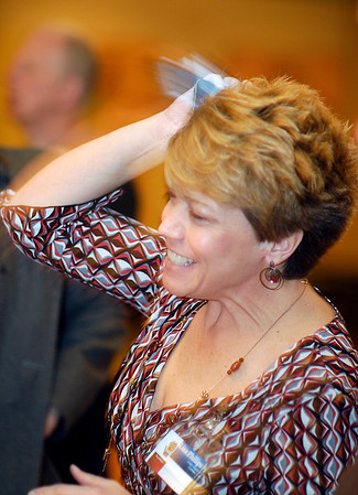 Lisa Phillips, Republican candidate for County Council At Large, reacts to the phone call she got telling her she had won a council seat before the results were posted at the Republican gathering at the Paramount Ballroom.