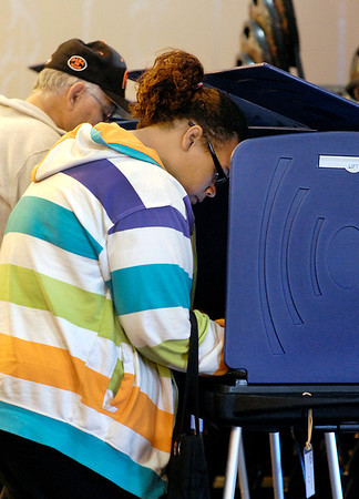 Iesha Weaver votes for the first time at Anderson Ward 1, precinct 2,  at Park Place Church of God.