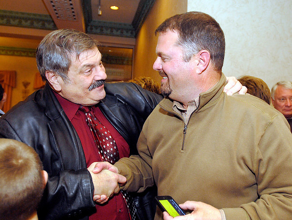 John Richwine, right, gets congratulations from Sam Hanna after Richwine had won his race for North District Commissioner.