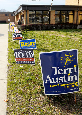 Election signs line the entrance to APA on 29th street on Tuesday.