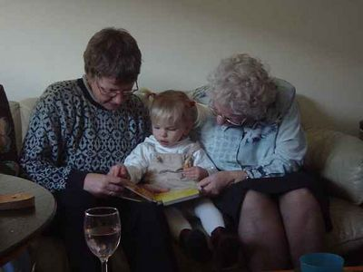 Aunt Else and Grandma reading to Elise