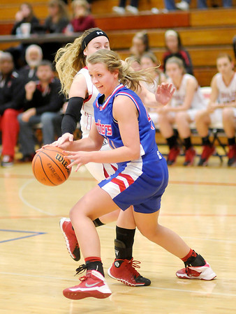 Don Knight / The Herald Bulletin<br /> Elwood faced Taylor in sectional action at Elwood High School on Wednesday.