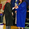 Mary Quillen receives a rose from Assistant Principal Shay Bonnell during the Elwood High School Commencement.