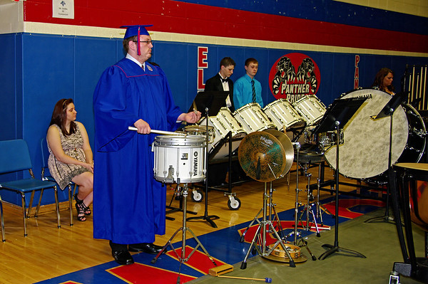 Graduating percussionist Andrew Harting plays his final performance wiith the Elwood High School Band during commencement ceremonies.