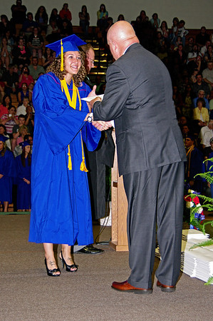 Graduating Senior Jesse Brown receives her diploma from Superintendent Thomas Austin during the commencement ceremony at Elwood High School.