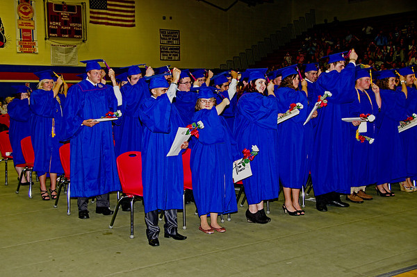 Elwood High School Graduates change their tassels at the conclusion of commencement.
