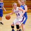 Elwood's Erica Harpel moves into the low post as she is guarded by Eastern Hancock's Peyton Neisler as the Panthers hosted the Royals on Wednesday.