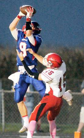 Don Knight/The Herald Bulletin<br /> Elwood's London Leavell intercepts a throw to Frankton's Dallas Blevins and returns it 101 yards for touchdown on Friday.