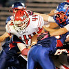 Don Knight/The Herald Bulletin<br /> The Elwood defense tackles Frankton's Isaiah Delph on Friday.