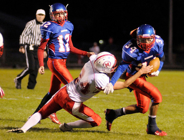 Elwood running back Bryce Graves tries to break the tackle of Mississinewa's Cory Markley as the Panthers hosted the Indians on Saturday.