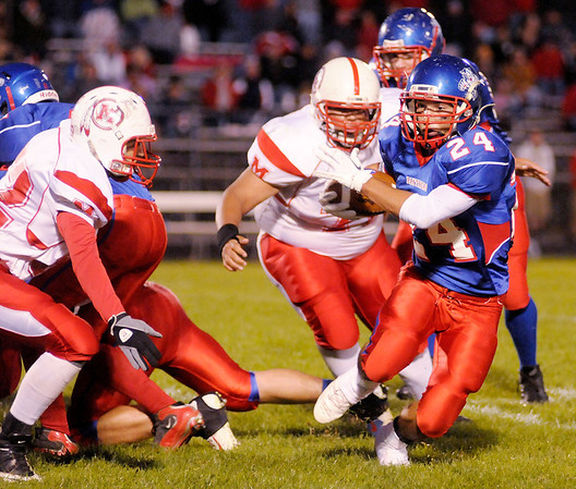 Elwood running back Sammy Mireles bounces to the outside as the Panthers hosted the Mississinewa Indians on Saturday.