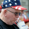In keeping with the spirit of the day, Richard Mulcahey of Janesville, sported a patriotic cap as he ate a milk shake at Elysian's Fourth of July celebration. Photo by John Cross