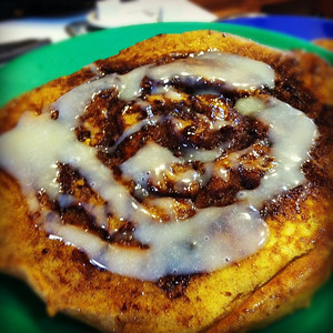 Cinnamon Swirl Pumpkin Pancakes with cream cheese icing
