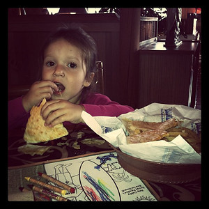 A enjoying her cheesy quesadilla.