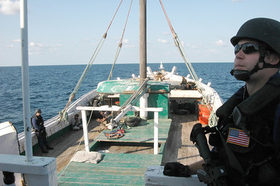 ABOARD CGC MIDGETT (Dec. 10, 2006) Petty Officer 3rd Class Robert Boyer, a gunners mate from Port Orchard Wash., aboard CGC Midgett, focuses with endless patience as his shipmates conduct a boarding of a vessel of interest, Dec 10, 2006 off the Coast of Oman.  Midgett, a 378-foot High Endurance Cutter, homeported in Seattle, has been deployed in support of Operation Enduring Freedom since September.   U.S. Coast Guard Photo by Petty Officer 2nd Class Mariana O'Leary.