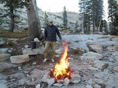 Dave, a natural pyro, keeps the hearth burning.