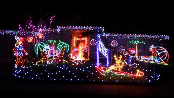 Mele Kalikimaka From Silver Lake Drive Where Their Christmas Decorations  Depict A Hawaiian Beach Scene December