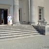 On the steps with one of the heraldic lions