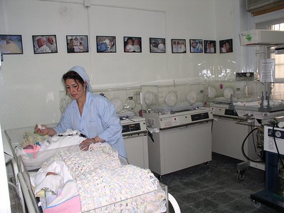 "A re-painted and high-cleaned nursery. Top to bottom scrubbing was done over a 24 hour period to get the place back to a perfect newborn environment. The babies in front are bundled and covered with ""afghans""."