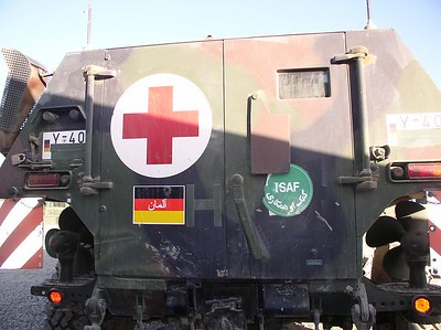 This is an ambulance tank, followed by military police. He was transported to a hospital in Kabul (different one than we removed him from). What a happy ending. The German MDS treated him with respect, dignity and gave me no trouble in granting the request for medical attention. Please keep him (Mohammed) in your prayers. He is 65 years old and a retired teacher.