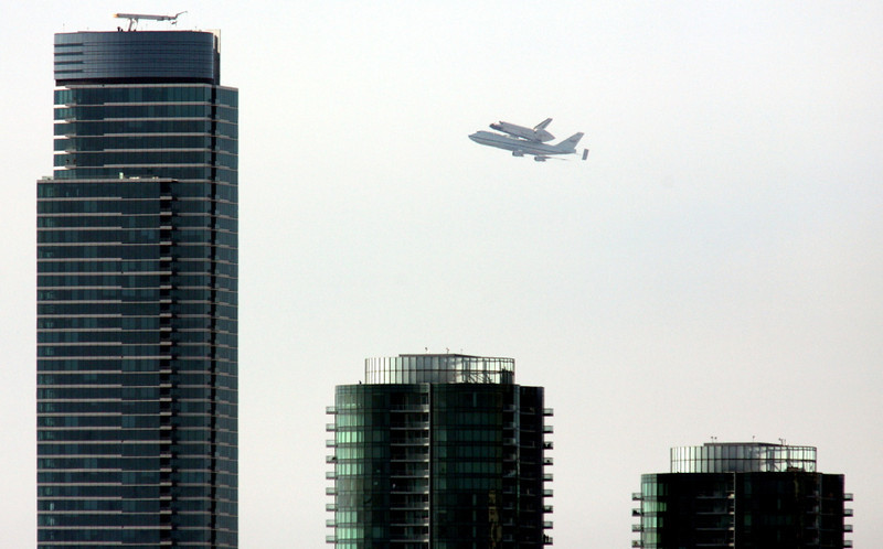 Endeavour flies over the Rincon One tower, left,  in San Francisco on Sept. 21, 2012.
