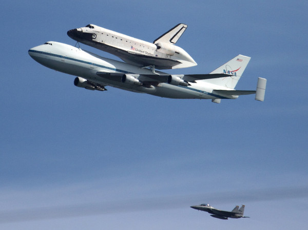 Endeavour and its chase plane fly over Treasure Island in San Francisco on Sept. 21, 2012.