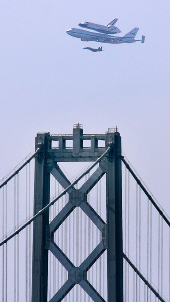 Endeavour flies by the Bay Bridge in San Francisco on Sept. 21, 2012.