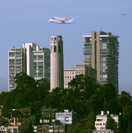 Endeavour flies by Coit Tower and Telegraph Hill in San Francisco on Sept. 21, 2012.