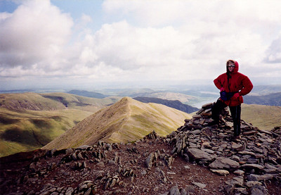 Lizzie at the top of Hellvellyn. Swirral Edge in the distance.