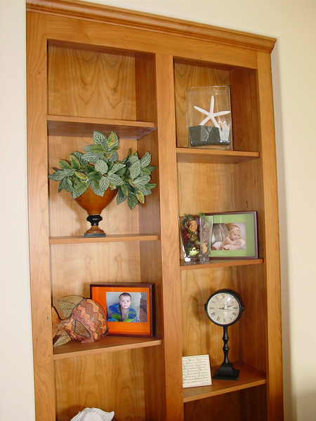 cherry bookcase with wide styles and thin shelvs