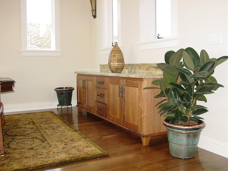 Walnut dining room buffett with furniture style feet