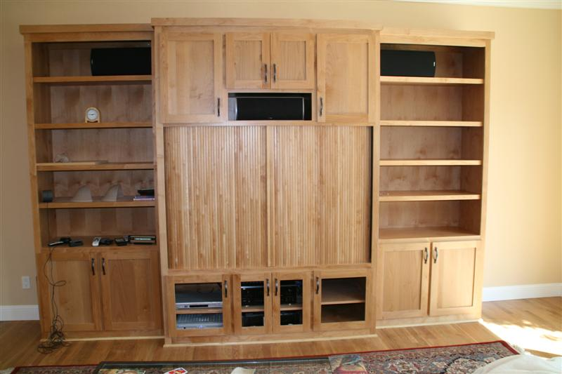 Alder cabinet with tambour doors to hide TV