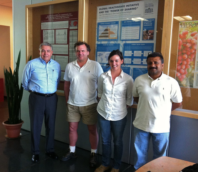 Professors, Ray Rodriguez, Eric Schadt, Research Analyst, Megan Doyle and Global HealthShare managing director, Dr. Somen Nandi in the lobby of the Plant Reproductive Biology Facility on the UC Davis campus.