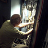 Tim Balint inspects a Comark amplifier cooling fan in the up-converter for KMIR 36