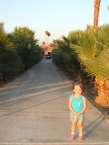 Payton standing in front of the driveway leading up to Uncle Sonny's home.