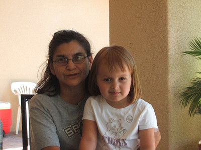 Mia with her Grandma Leti Esquivel.  They are sitting in the front porch of Tio Sonny's house.